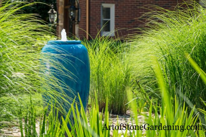 Teal fountain and grasses