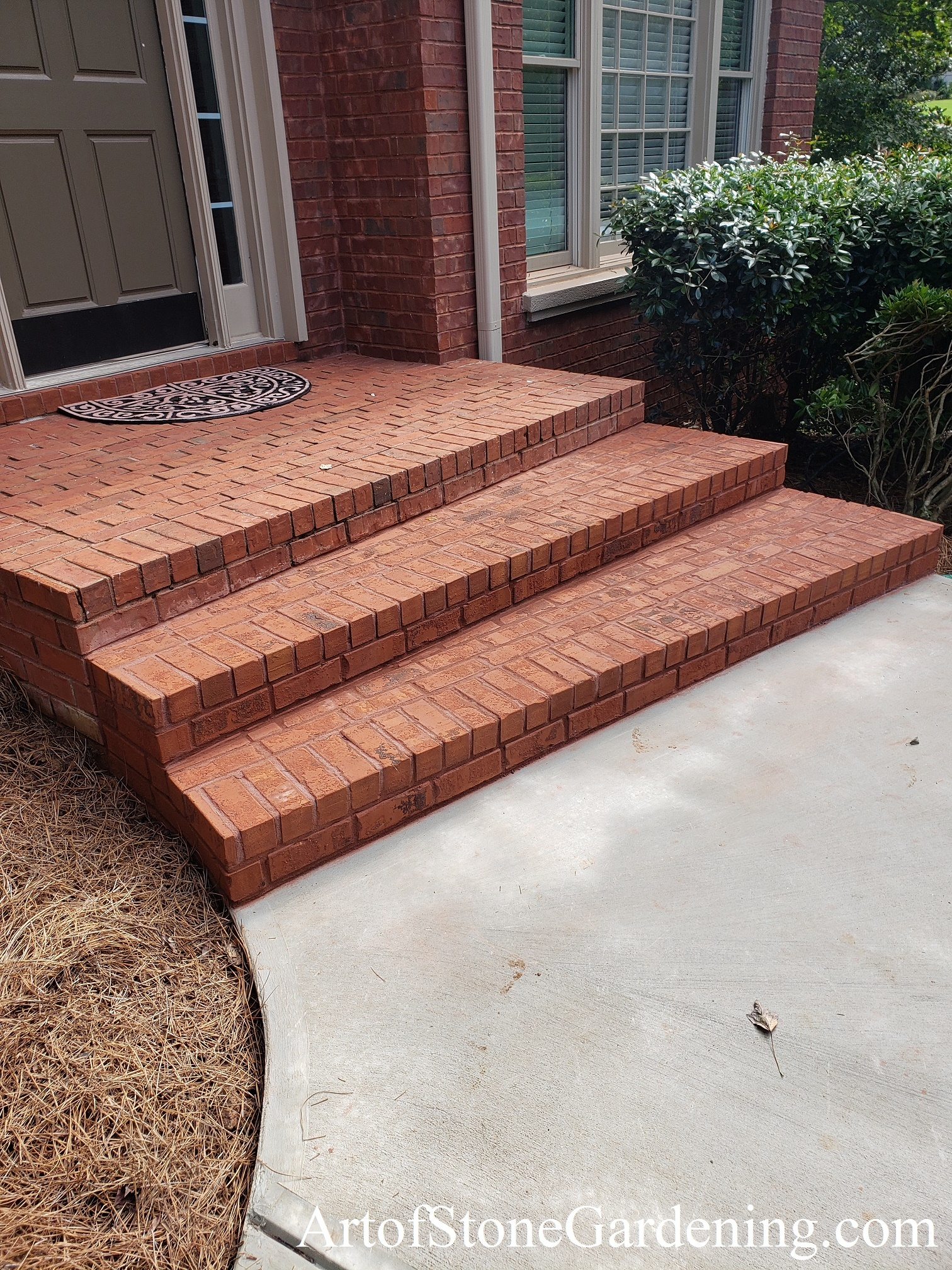 Newly replaced brick steps and front stoop