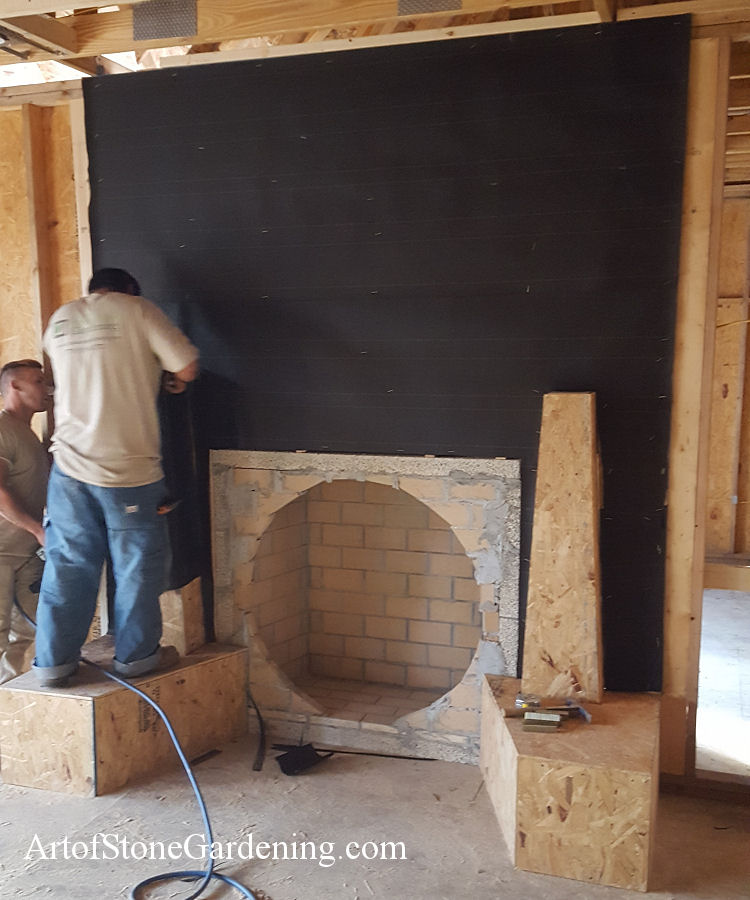 building stone circle shaped fireplace