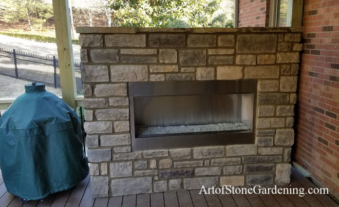 Stone fireplace on patio