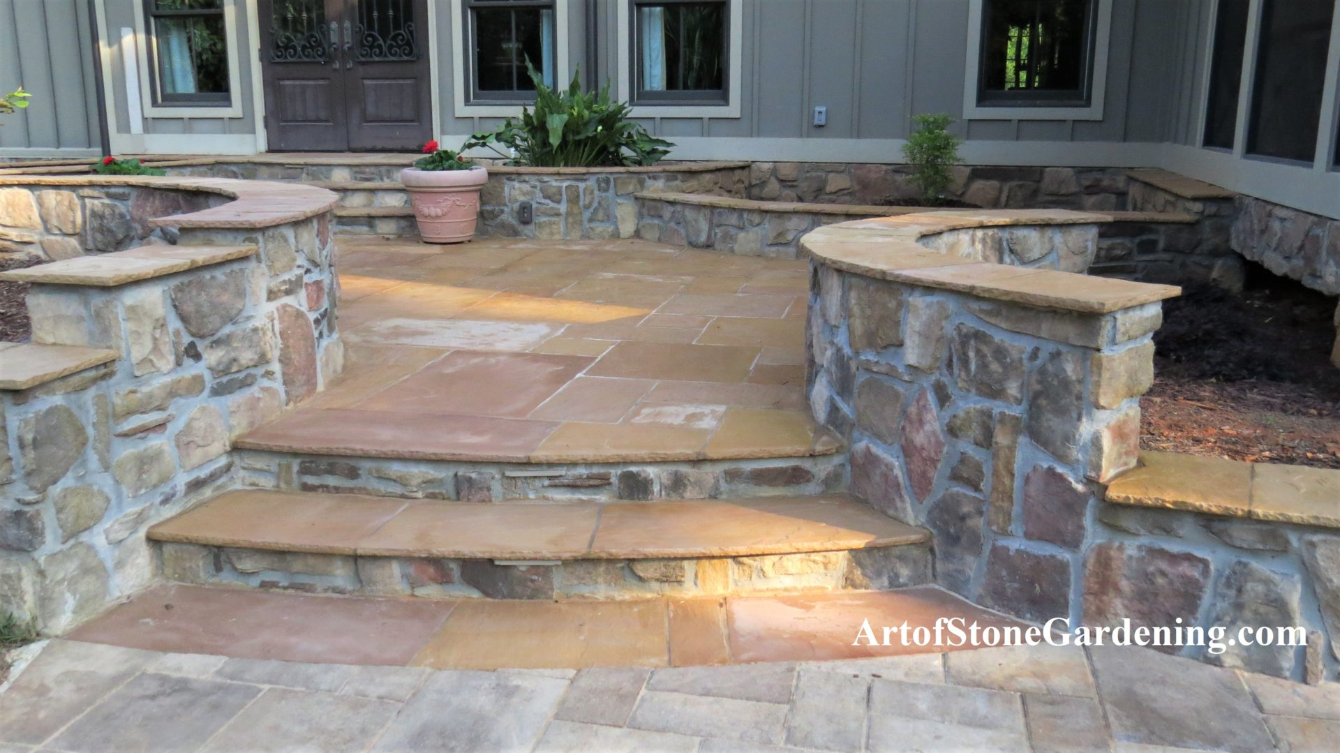 Stone patio and raised beds