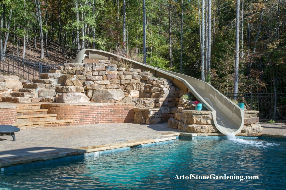 Stone boulder wall for pool slide in Gainesville, GA