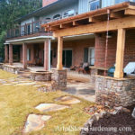 Custom patio, outdoor kitchen and cedar arbor with copper gutters and rain chain