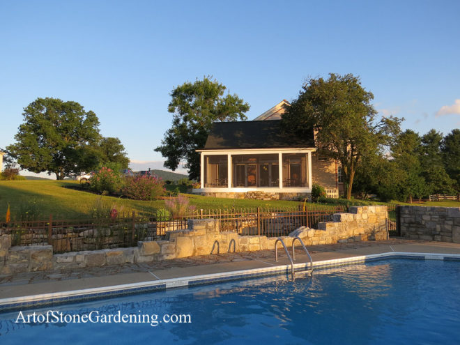 Stone wall around pool