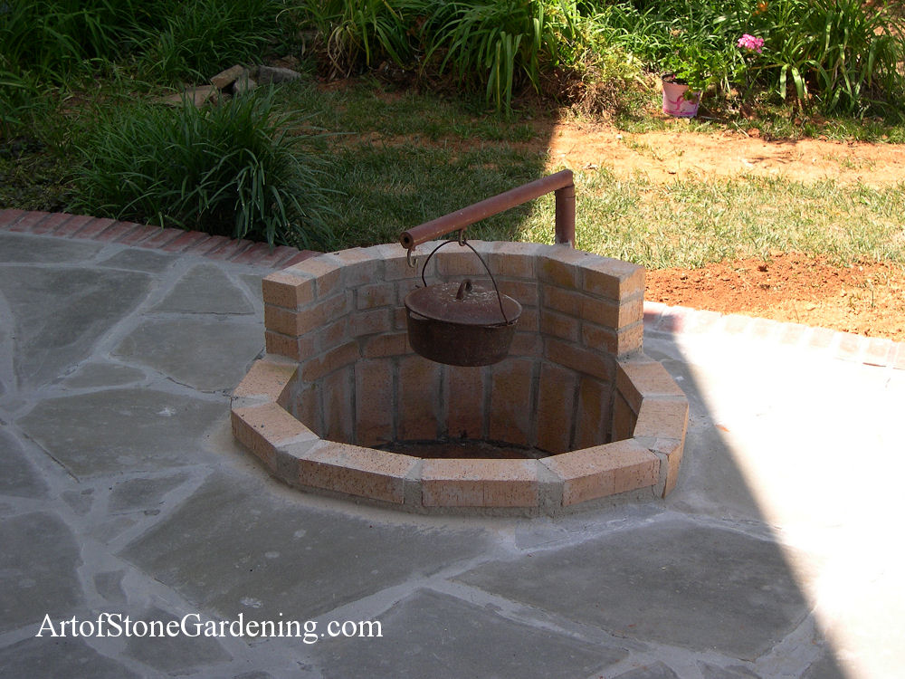 Firepit with swing arm for cooking