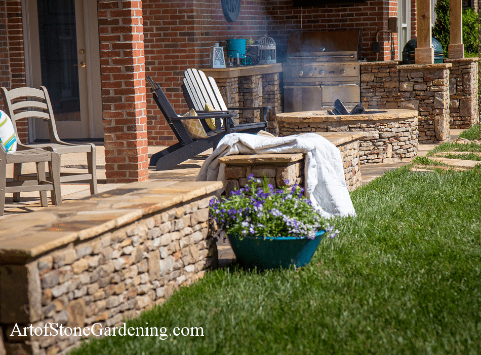 Stone firepit and outdoor kitchen