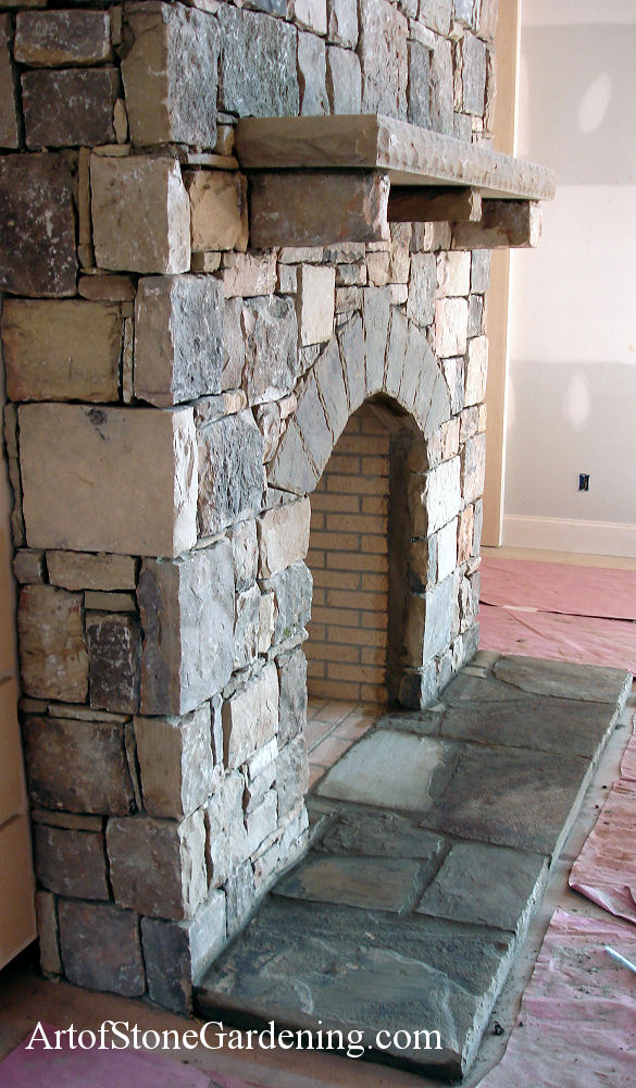 Masonry fireplace with arched opening