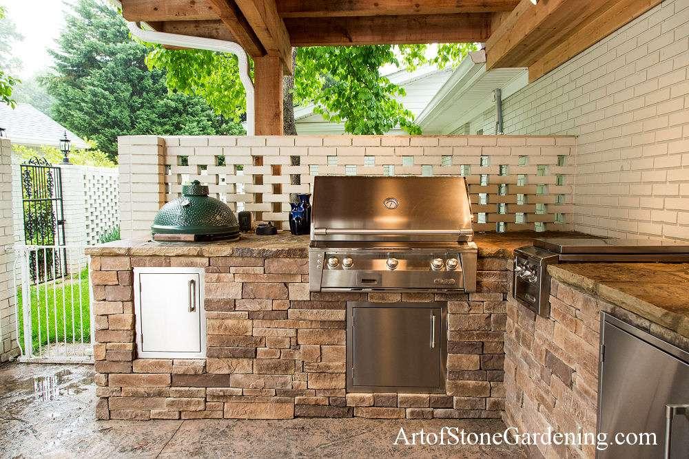 Under deck stone outdoor kitchen