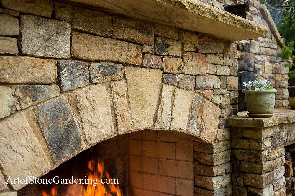 Arched masonry fireplace