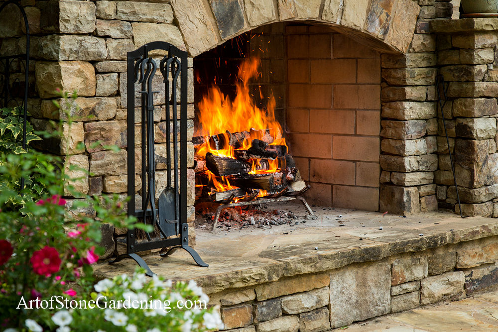 Custom stacked stone arched fireplace