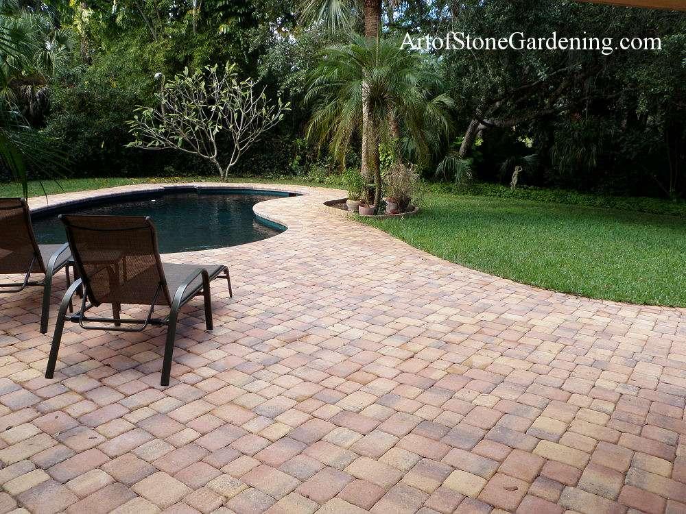 Paving stone patio around a pool