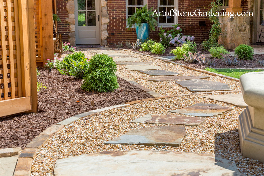 Stepping stones in pea gravel with stone edging