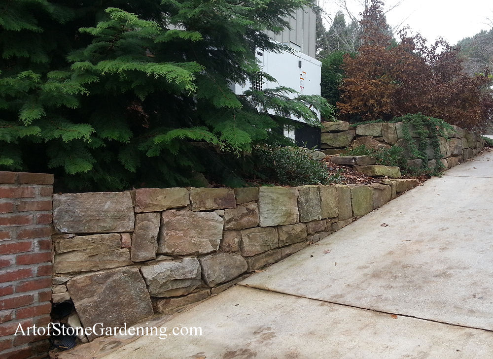 Boulder retaining wall and garden in Gainesville