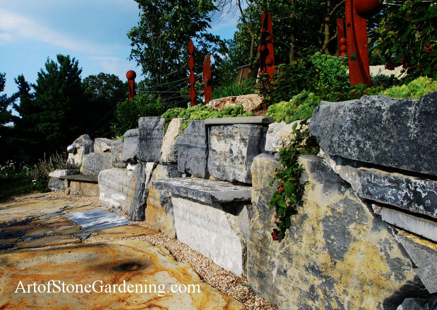 This is a stone gravity retaining wall made from 1-ton boulders.