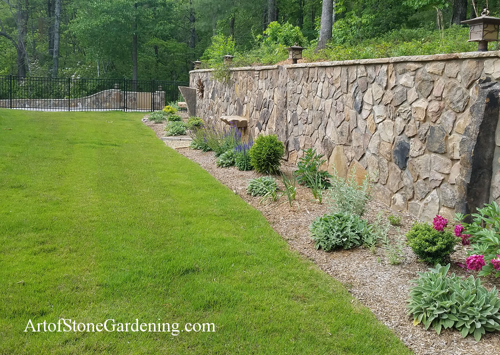 Stone retaining wall with garden