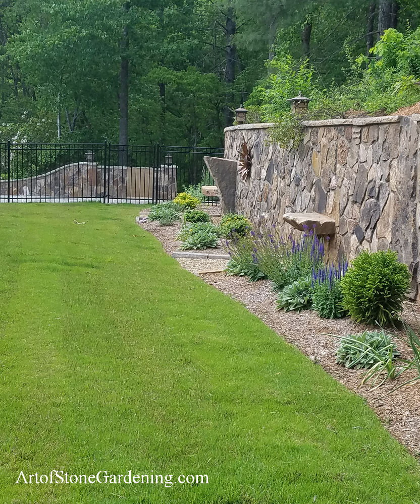 Stone wall with stone seats built in