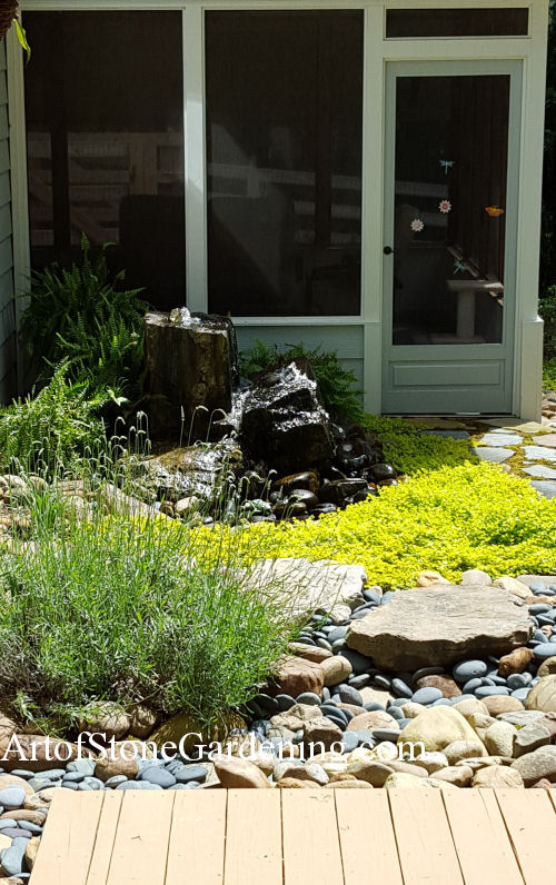 Boulder water feature and garden
