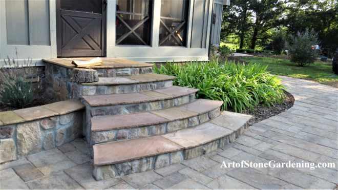 Back yard stone steps, raised stone planters and walkway